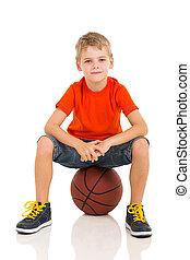 kid sitting on a basketball - cute kid sitting on a...