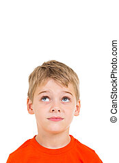 cute little boy looking up at empty copy space