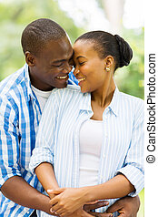 african couple hugging outdoors