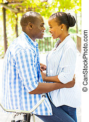 african american couple with a bicycle - beautiful african...