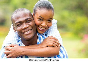 loving african couple - close up portrait of loving african...