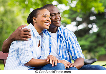 young african couple daydreaming - cute young african...