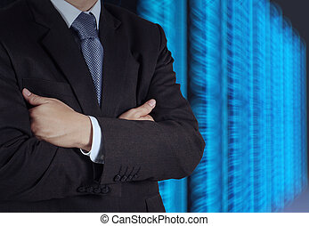 businessman hand using tablet computer and server room backgroun