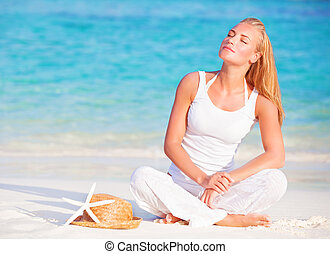 Gentle woman on the beach