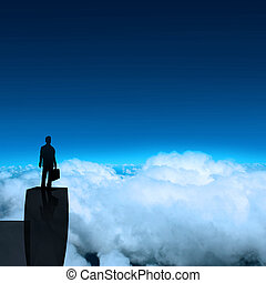 businessman stands successfully on building top Looking...