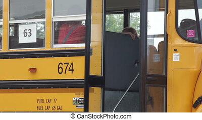 Kids walking to school - High school kids getting off a bus...