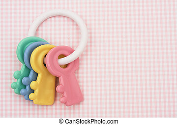 Baby Rattle - Colourful baby rattle on a pink background,...