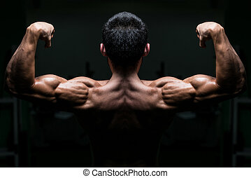 Young Male Athlete Flexing Back Muscles