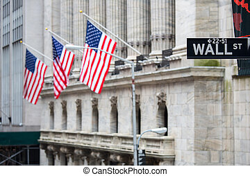Wall street sign in New York with New York Stock Exchange...