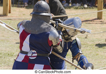 Medieval fighting - Two medieval knights are fighting hardly...