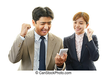 Business people enjoying success - Businessman and...