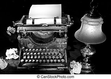 typewriter with lamp on desktop