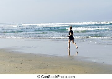 Barefoot running, Pacific Beach - A woman wearing shorts...