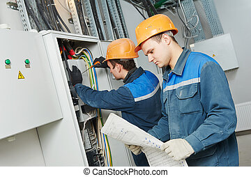 two electrician workers - two electrician builder engineer...