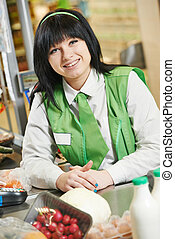 Shopping. Cashdesk worker in supermarket - Portrait of Sales...