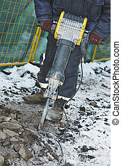 construction road works with jack hammer - Builder worker...