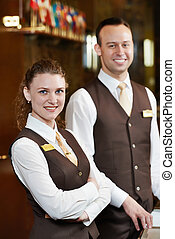 Hotel workers on reception - Happy receptionist workers...