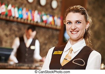 Hotel worker on reception - Happy receptionist female worker...