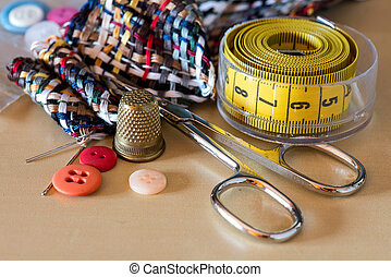 sewing kit accessories on wooden table