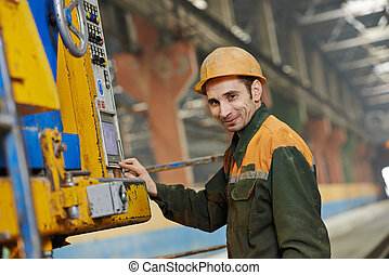 industrial worker operating machine - industrial worker...