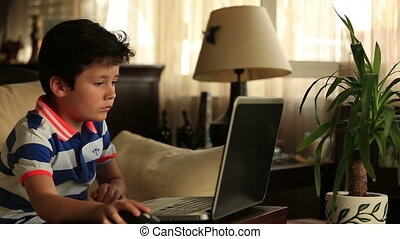 little child with laptop - little child doing homework on...