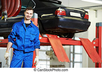 Repairman auto mechanic at work