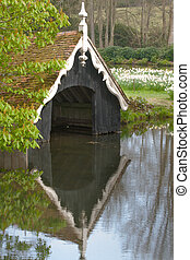 boat house with reflections on water