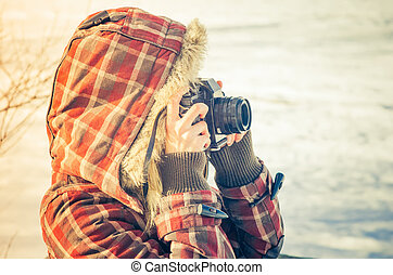 Woman photographer with retro photo camera outdoor Lifestyle...