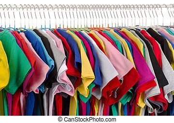casual clothing - Rack of assorted colored T-shirts. Isolate...