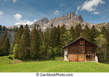wooden barn in idylic mountain scenery