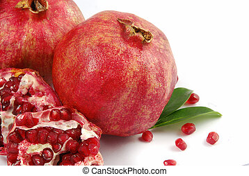 Pomegranate - Fresh ripe pomegranate with a half on white