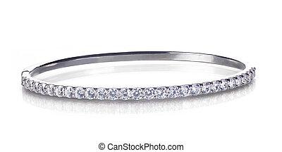 Diamond and gold bangle bracelet isolated on white