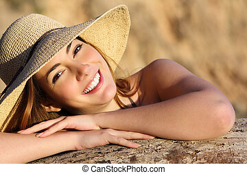Portrait of a happy woman smiling with perfect white smile...