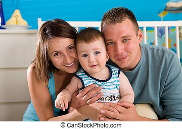 Happy family at home - Portrait of happy family at home Baby...