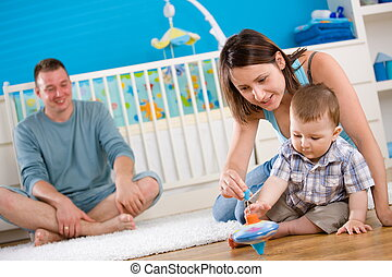 Happy family playing at home - Portrait of happy family at...