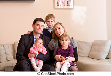 Familiy portrait - Portrait of happy family sitting on couch...