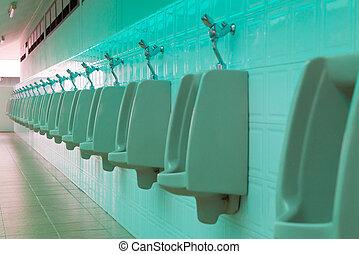 porcelain urinals in public toilets
