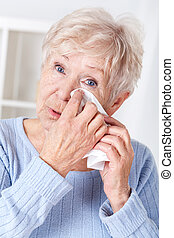 Elderly woman crying - Portrait of sad elderly woman...