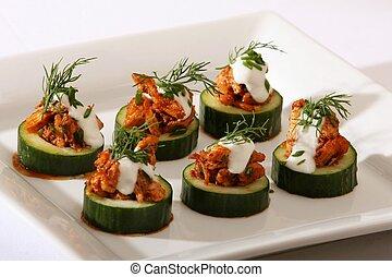 Thai Chicken in Cucumber Slices - Cucumber slices filled...