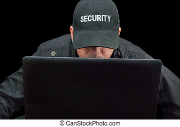 Security Working On Laptop, Brim Down - Close-up of security...
