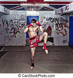 Muay Thai - A Muay Thai figher warming up in a sburban...