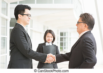 Business deal, Asian businessmen handshaking. Senior CEO...