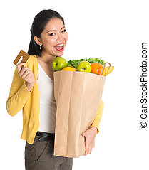 Groceries shopping with credit card - Happy young pan Asian...