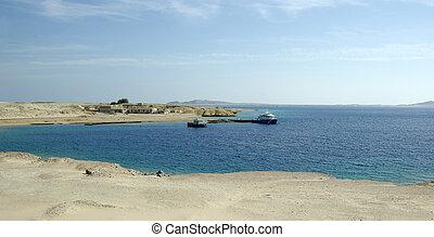Ships in bay. Red sea, Egyptian desert.