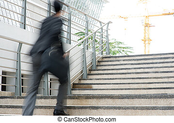 Businessman in hurry Motion blurred people over office...