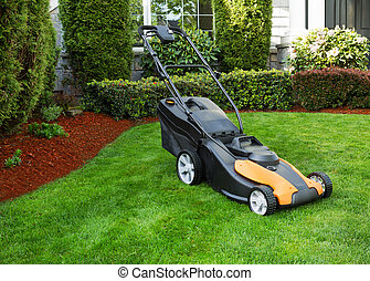 Electric Battery Lawn Mower on Front Yard - Photo of...