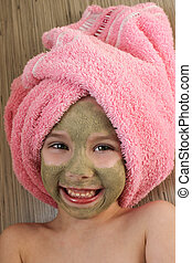 girl with clay mask facial