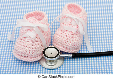 Healthcare Costs - A pair of pink baby booties and a...