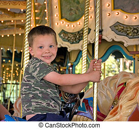 Little Boy On Merry Go Round - A very happy little 5 year...