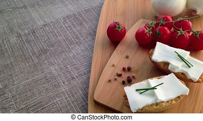 Crispbread with fresh cheese, tomato, white onions and...